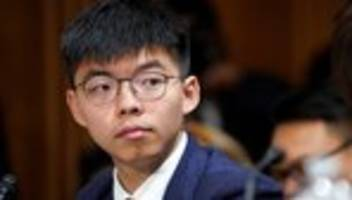 hongkong: aktivisten prangern polizeistaat mit polizeigewalt an