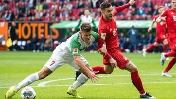 fußball-bundesliga: augsburg entreißt bayern derbysieg - süle am knie verletzt