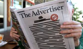 Australiens Zeitungen schwärzen ihre Titelseiten nach Razzien