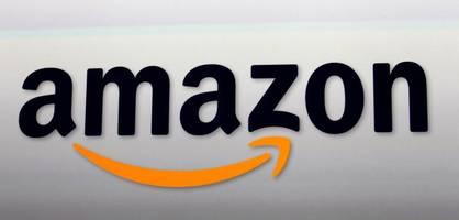 aktivisten schließen bündnis gegen amazon