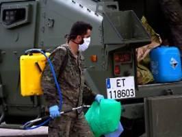 832 corona-opfer an einem tag: spaniens armee soll tote abtransportieren