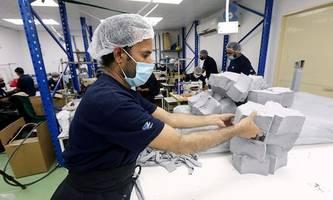 Supermärkte präsentieren Masken-Pläne, weitere Gemeinden unter Quarantäne