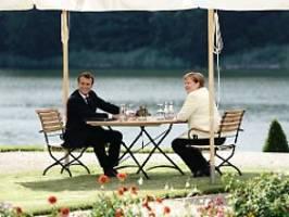 Kanzlerin erneut ohne Maske: Merkel und Macron verteidigen Milliardenplan