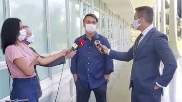 Ohne Mindestabstand: Bolsonaro verkündet Corona-Infektion vor Reportern – und nimmt sogar die Maske ab