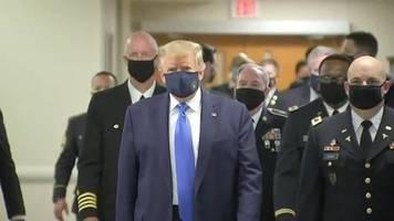 Video: Trump trägt bei öffentlichem Auftritt Gesichtsmaske