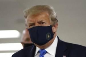 Corona-Krise: Trump trägt Maske - Rekord an Neuinfektionen in den USA