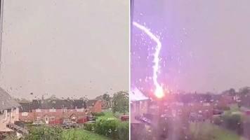 Blitzeinschlag in Transformator: Frau filmt Unwetter vor ihrem Haus – dann bekommt sie einen Riesenschreck