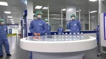 video: spahn besucht abfüllanlage für corona-impfstoff