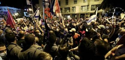 tausende demonstrieren in israel gegen die corona-maßnahmen