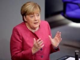 Bundestag: Merkel erläutert die neuen Corona-Beschränkungen