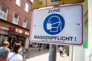 Corona-Pandemie: Maskenpflicht: Experten warten vor Verzicht in Innenräumen