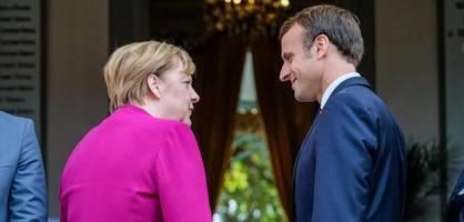 merkel und macron informieren über abstimmung zwischen deutschland und frankreich