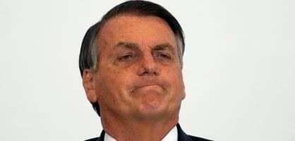 Ungeimpfter Bolsonaro isst Pizza auf dem Bürgersteig wegen Corona-Regeln