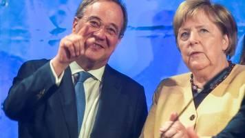 Merkel lobt Laschet als Garanten für Arbeitsplätze und Sicherheit